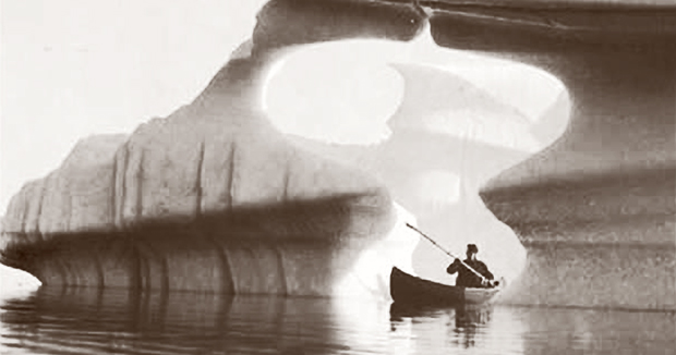 Our Founder, Arthur D. Norcross paddling through ice